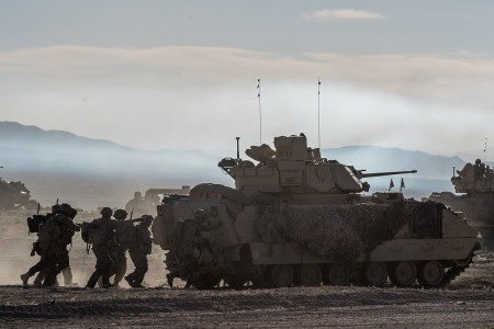 Army National Guard Infantrymen from the 116th Cavalry Brigade Combat Team seize a town from the enemy, June 7, 2019, at the National Training Center in Fort Irwin, Calif.
