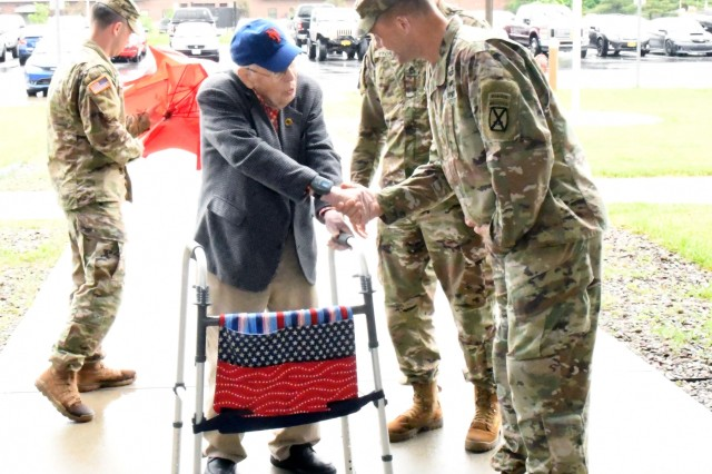 Don Waful, a native of Syracuse, New York, and World War II veteran, is greeted by Maj. Gen. Brian J. Mennes, 10th Mountain Division (LI) and Fort Drum commander, during a visit June 20 to Fort Drum. (Photo by Mike Strasser, Fort Drum Garrison Public Affairs)