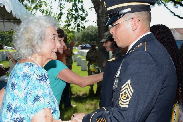 Command Sergeant Gilberto Colon, Command Sergeant Major, 187th Medical Battalion, greets Mrs. Rita Van Autreve during a ceremony honoring SMA (Ret) Leon Van Autreve June 21, 2019 at JBSA-Fort Sam Houston.