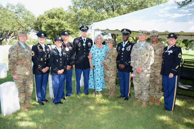 U.S. Army Medical Department Noncommissioned Officer Academy cadre pictured with Mrs. Rita Van Autreve  (center) during a ceremony honoring SMA (Ret) Leon Van Autreve June 21, 2019 at JBSA-Fort Sam Houston.