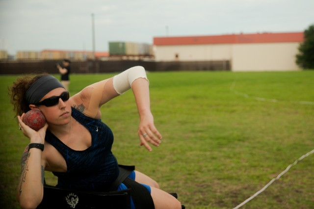 U.S. Army Capt. Mya Gordon, prepares to launch a shot put during field practice on June 19, 2019, MacDill Air Force Base during the 2019 Department of Defense Warrior Games. The DoD Warrior Games are conducted June 21 - 30, hosted by Special Operations Command, Tampa, Florida. It is an adaptive sports competition for wounded, ill and injured service members and veterans. Approximately 300 athletes representing teams from the Army, Marine Corps, Navy, Air Force, Special Operations Command, United Kingdom Armed Forces, Australian Defence Force, Canadian Armed Forces, Armed Forces of the Netherlands, and the Danish Armed Forces will compete in archery, cycling, shooting, sitting volleyball, swimming, track, field, wheelchair basketball, indoor rowing, powerlifting, and for the first time in Warrior Games history, golf, wheelchair tennis, and wheelchair rugby. (U.S. Army photo by Staff Sgt. Michael Loggins)
