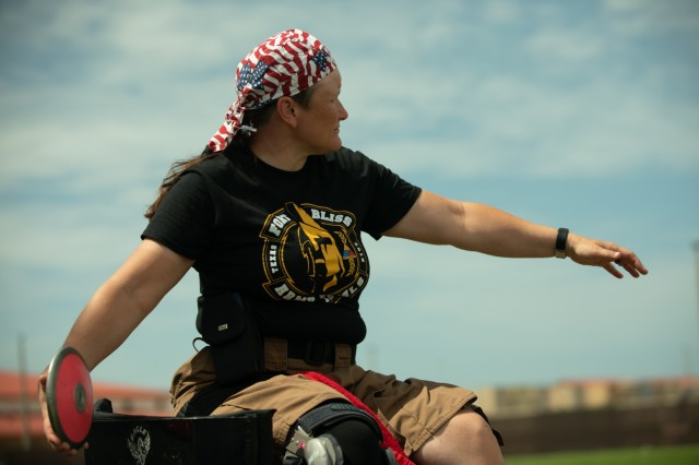 U.S. Army Sgt. 1st Class Tiffany Rodriguez-Rexroad, throws a discus during a break from Field practice on June 19, 2019, MacDill Airbase during the 2019 Department of Defense Warrior Games. The DoD Warrior Games are conducted June 21 - 30, hosted by Special Operations Command, Tampa, Florida. It is an adaptive sports competition for wounded, ill and injured service members and veterans. Approximately 300 athletes representing teams from the Army, Marine Corps, Navy, Air Force, Special Operations Command, United Kingdom Armed Forces, Australian Defence Force, Canadian Armed Forces, Armed Forces of the Netherlands, and the Danish Armed Forces will compete in archery, cycling, shooting, sitting volleyball, swimming, track, field, wheelchair basketball, indoor rowing, powerlifting, and for the first time in Warrior Games history, golf, wheelchair tennis, wheelchair rugby, and mountain biking. (U.S. Army photo by Staff Sgt. Michael Loggins)