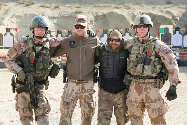 Bagram Airfield Range Officer Stephen Eger poses with Coalition Forces at Maholic Range.