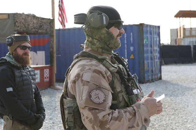 Stephen Eger, range officer at Maholic Range, listens in during a mission-safety briefing for the Czech Republic soldiers training Dec. 11, 2018. The Czech soldiers provide force protection patrolling outside of Bagram Airfield, Afghanistan.