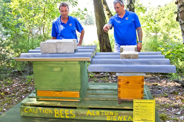 "Jerry Beierschmitt (left) and Joel ""Dusty"" Rhodes check on bee hives at the Rheinblick Golf Course."