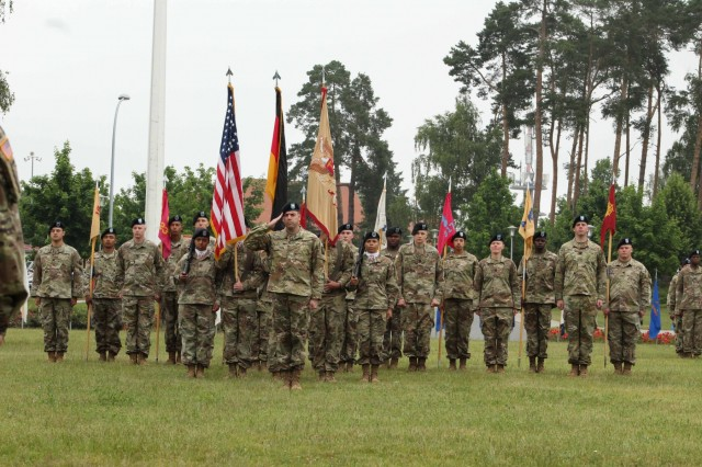 Soldiers of the 18th Combat Sustainment Support Battalion salute during the playing of the National Anthem during a Change of Command ceremony at Tower Barracks Parade Field, Grafenwoehr, Germany, June 21, 2019. During the ceremony outgoing Commander Lt. Col. Jonathan W. Meisel formally relinquished his authority, responsibility and accountability of the 18th CSSB to incoming Commander Lt. Col. Charles V. Jaquillard. (U.S. Army photo by Staff Sgt. Sinthia Rosario, 16th Sustainment Brigade Public Affairs)