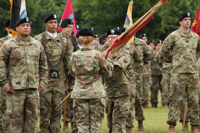 Lt. Col. Jonathan W. Meisel, outgoing commander, 18th Combat Sustainment Support Battalion, passes the unit colors to Col. Michelle K. Donahue, commander, 16th Sustainment Brigade, during a Change of Command ceremony at Tower Barracks Parade Field, Grafenwoehr, Germany, June 21, 2019. During the ceremony, Meisel formally relinquished his authority, responsibility and accountability of the 18th CSSB to incoming Commander Lt. Col. Charles V. Jaquillard. (U.S. Army photo by Staff Sgt. Sinthia Rosario, 16th Sustainment Brigade Public Affairs)