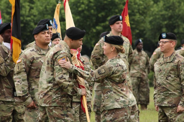 Col. Michelle K. Donahue, commander, 16th Sustainment Brigade, passes the unit colors to Lt. Col. Charles V. Jaquillard, incoming commander, 18th Combat Sustainment Support Battalion during a Change of Command ceremony at Tower Barracks Parade Field, Grafenwoehr, Germany, June 21, 2019. During the ceremony, outgoing Commander Lt. Col. Jonathan W. Meisel formally relinquished his authority, responsibility and accountability of the 18th CSSB to Jaquillard. (U.S. Army photo by Staff Sgt. Sinthia Rosario, 16th Sustainment Brigade Public Affairs)