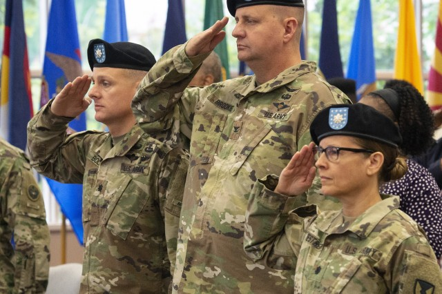 (From left) Lt. Col. Thomas R. Boland, outgoing commander, Army Field Support Battalion-Alaska; Col. Chris Brookie, commander, 402nd Army Field Support Brigade; and Lt. Col. L. Pily Restrepo, incoming commander, AFSBn-Alaska, salute during the battalion's change of command ceremony at Joint Base Elmendorf-Richardson, Alaska, June 18.