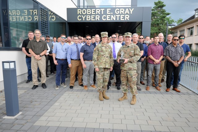 NETCOM Commanding General, Maj. Gen. Maria Barrett, stands with to Lt. Col. Howie Smyth, Director of Regional Cyber Center -- Europe, and the team of cyber warriors that operate the Robert E. Gray Cyber Center -- Europe, after presenting the Regional Cyber Center of the Year award.