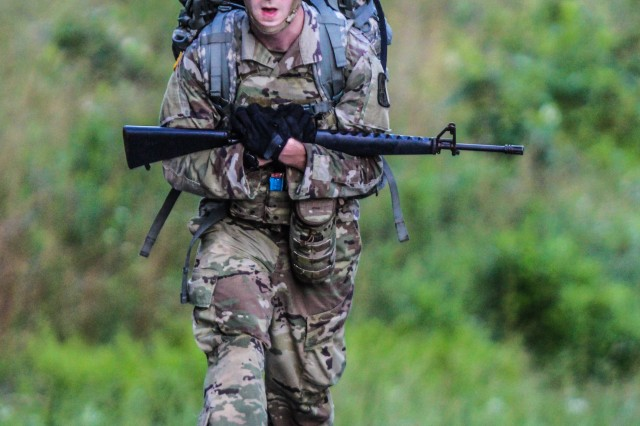 Spc. Jonathan Carter, a signals intelligence analyst assigned to the 116th Military Intelligence Brigade marches with his weapon during the 12-mile ruck march at the 2019 U.S. Army Intelligence and Security Command's Best Warrior Competition at Fort A.P. Hill, Virginia, June 4.