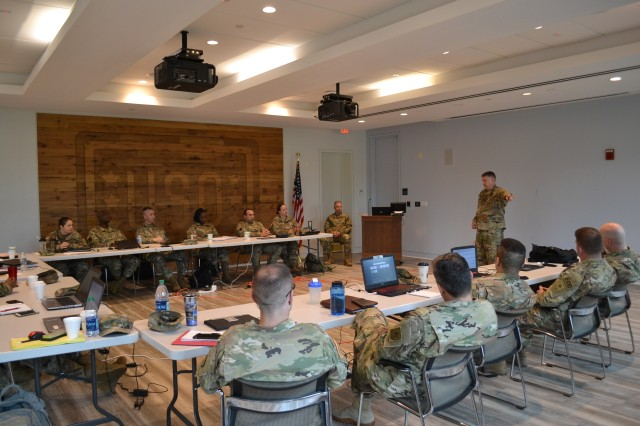 Brig. Gen. Aaron Walter, commander of the 100th Training Division-Leader Development, visits the officers attending the Command and General Staff Officer Course Phase Two 4x4 Course at Fort Belvoir, Virginia, June 10, 2019. The 4x4 course is a pilot program that allows Army officers to complete the second of three phases in person during four weekends instead of the previous option of eight weekend classes or through distance learning.