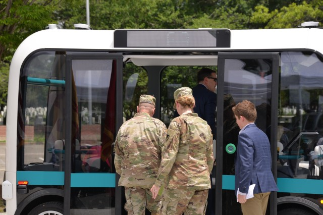 Guests board Olli, an autonomous vehicle, for shuttle service on Joint Base Meyers-Henderson Hall (JBM-HH) June 19, 2019. Olli will provide service on JBM-HH for 90 days as part of a pilot project in autonomous vehicle technology for which The U.S. Army Corps of Engineers' (USACE) Engineer Research and Development Center is the research lead.