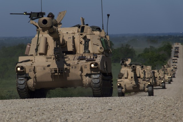 Georgia Army National Guardsmen with the Elberton based 1st Battalion, 214th Field Artillery Regiment conduct movement during the Kansa National Guard's Big Bow, a brigade artillery exercise featuring Guardsmen from Kansas, Missouri and Georgia at Fort Riley, Kan., on June 11, 2019. The battalion conducted three weeks of active duty training focused on combined fire capability with other National Guard units.U.S. Army National Guard photo by Sgt. 1st Class R.J. Lannom Jr