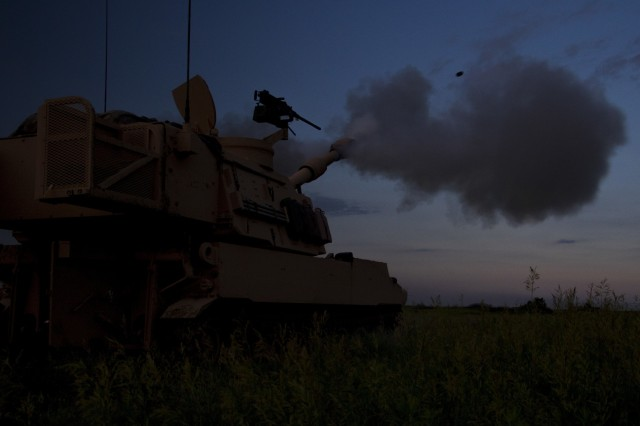 Georgia Army National Guardsmen with the Elberton based 1st Battalion, 214th Field Artillery Regiment fire at dusk during Operation Big Bow, a National Guard brigade artillery exercise featuring Guardsmen from Kansas, Missouri and Georgia at Fort Riley, Kan., on June 11, 2019.  The battalion conducted three weeks of active duty training focused on combined fire capability with other National Guard units.U.S. Army National Guard photo by Sgt. 1st Class R.J. Lannom Jr.