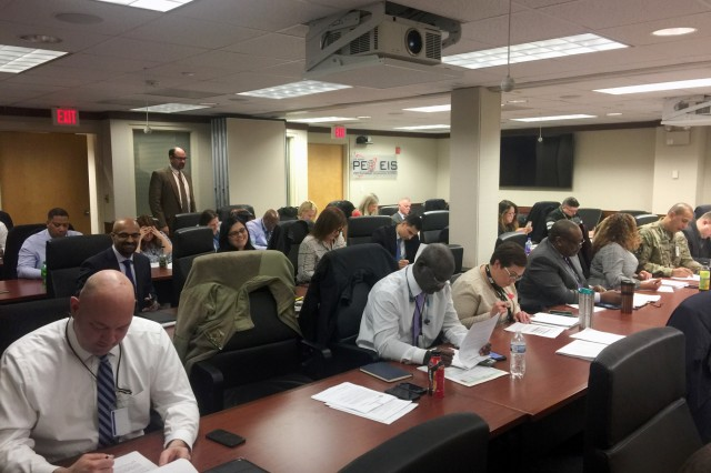The class at PEO EIS at Fort Belvoir works on a problem. (Photos courtesy of Dr. Robert F. Mortlock)