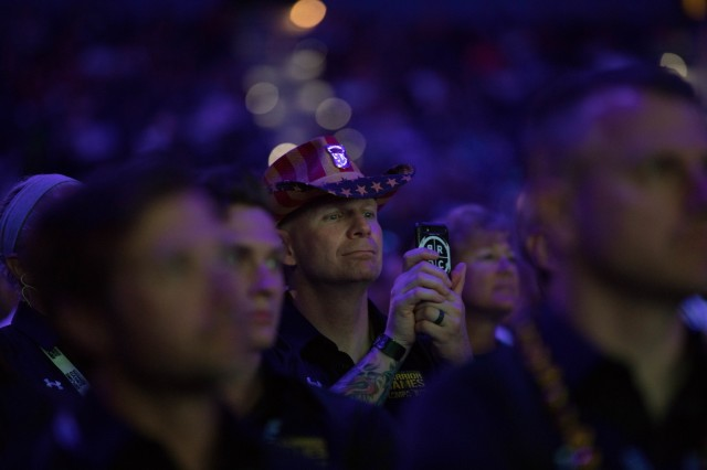 U.S. Army Sgt. 1st Class Joseph Fontenot watches the opening ceremony at Amalie Arena in Tampa, Florida, June 22, 2019, during the 2019 Department of Defense Warrior Games. The DoD Warrior Games are conducted June 21-30, hosted by Special Operations Command, Tampa, Florida. It is an adaptive sports competiton for wounded, ill, and injured service members and veterans. Approximately 300 athletes, representing teams from the Army, Marine Corps, Navy, Air Force, Special Operations Command, United Kingdom Armed Forces, Australian Defense Force, Canadian Armed Forces, Armed Forces of the Netherlands, and the Danish Armed Forces will compete in archery, cycling, shooting, sitting volleyball, swimming, track, field, wheelchair basketball, indoor rowing, and powerlifting. (U.S. Army photo by Spc. Katelyn Strange)