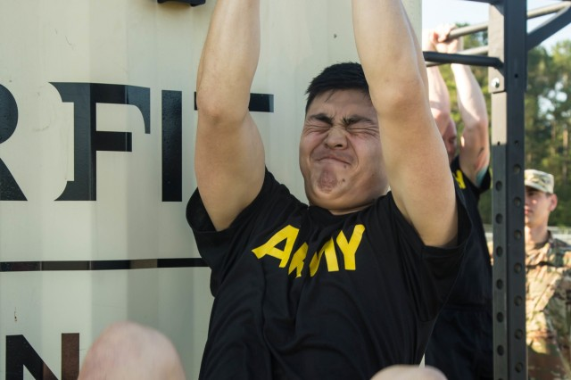 Sgt. Darren Kim, infantryman with 101st Airborne Division (Air Assault), performs the leg-tuck exercise of the Army Combat Fitness Test during the 2019 XVIII Airborne Corps Noncommissioned Officer and Soldier of the Year Competition at Fort Bragg, N.C. June 24, 2019. The competition places the best of the best against each other in a week-long competition.(U.S. Army Photo by Pfc. Joshua Cowden / 22nd Mobile Public Affairs Detachment
