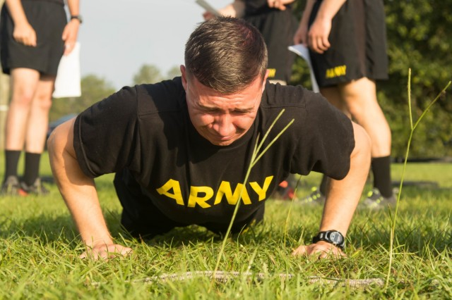 U.S. Army Sgt. Nicolas Branch, multichannel transmission systems operator-maintainer with 82nd Airborne Division, participates in the hand release push-up portion of the Army Combat Fitness Test during the 2019 XVIII Airborne Corps Noncommissioned Officer and Soldier of the Year Competition at Fort Bragg, N.C. June 24, 2019. The competition places the best of the best against each other in a week-long competition. (U.S. Army Photo by Pfc. Joshua Cowden / 22nd Mobile Public Affairs Detachment)