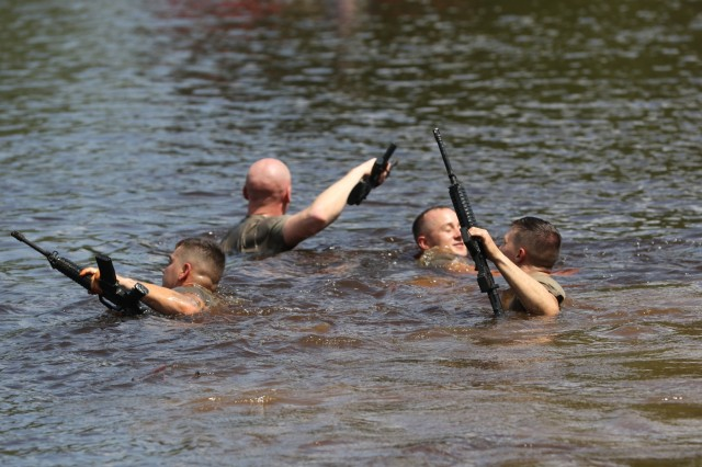 U.S. Army Soldiers swim across McKellar's Pond during the combat water survival training event of the 2019 XVIII Airborne Corps Noncommissioned Officer and Soldier of the Year Competition at Fort Bragg, N.C. June 24, 2019. The competition places the best of the best against each other in a week-long competition. (U.S. Army Photo by Pfc. Joshua Cowden / 22nd Mobile Public Affairs Detachment)