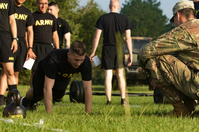 A U.S. Army Soldier completes the hand-release push-up event as part of the 2019 XVIII Airborne Corps Noncommissioned and Soldier of the Year competition June 24, 2019 at Fort Bragg, N.C. The best of the best Soldiers attend the week-long competition, embodying the Warrior Ethos and demonstrating their commitment to the Army Values. (U.S. Army photo by Pfc. Nathaniel Gayle, 22nd Mobile Public Affairs Detachment)
