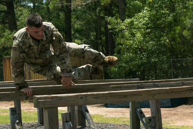 Cpl. Joshua Cooper, assigned to the 20th Engineer Brigade, vaults over an obstacle while competing in the 2019 XVIII Airborne Corps Noncommissioned Officer and Soldier of the Year Competition June 24, 2019 on Fort Bragg, N.C. The best of the best Soldiers attend the week-long competition, embodying the Warrior Ethos and demonstrating their commitment to the Army Values. (U.S. Army photo by Pfc. Nathaniel Gayle, 22nd Mobile Public Affairs Detachment)