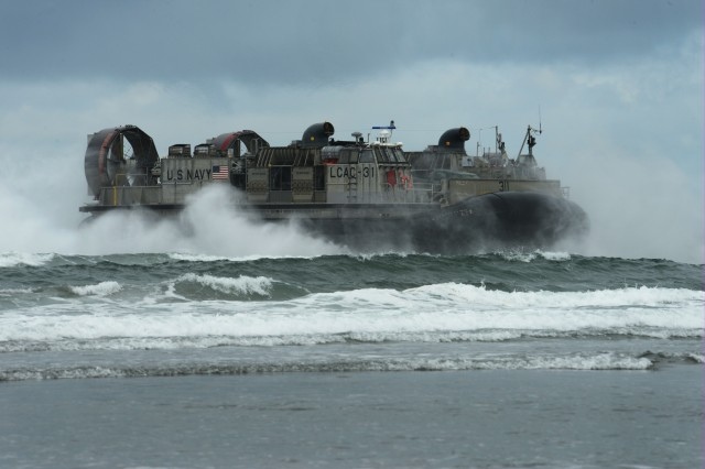 The U.S. Navy LCAC-31 (Landing Craft Air Cushion) comes ashore at the Sunset Beach are near Warrenton, Oregon, June 3, 2019. In addition to the beach landings by the hovercraft vehicles, community leaders, emergency managers, military officials and other first responders toured the U.S.S. Anchorage to learn more about the Navy capabilities to assist in mass casualty scenarios.