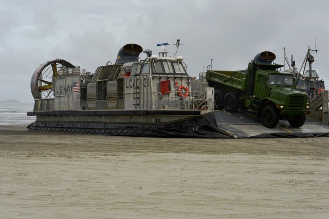 A U.S. Navy LCAC (Landing Craft Air Cushion) unloads heavy equipment off the hovercraft vehicle at Sunset Beach near Warrenton, Oregon, June 3, 2019. In addition to the beach landings by the LCAC's, community leaders, emergency managers, military officials and other first responders toured the  U.S.S. Anchorage to learn more about the Navy capabilities to assist in mass casualty scenarios.