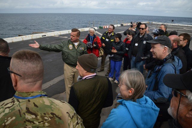 U.S. Navy Captain Dennis Jacko, commanding officer, U.S.S. Anchorage gives a briefing to visitors aboard the ship just off the coast of Warrenton, Oregon, June 3, 2019. Community leaders, emergency managers, military officials and other first responders toured the ship and road an LCAC (Landing Craft, Air Cushion) vehicle from shore to ship to learn more about the Navy capabilities to assist in mass casualty scenarios.
