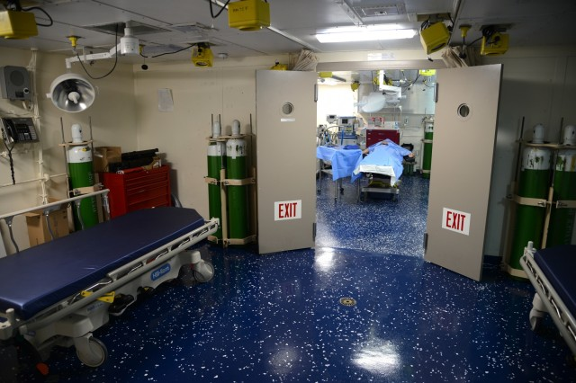 A medical treatment area aboard the U.S.S. Anchorage is set up for a group touring the ship, positioned off the Warrenton, Oregon shoreline, June 3, 2019. Community leaders, emergency managers, military officials and other first responders toured the ship and road aboard an LCAC (Landing Craft Air Cushion) from shore to ship to learn more about Navy capabilities to assist in mass casualty scenarios.
