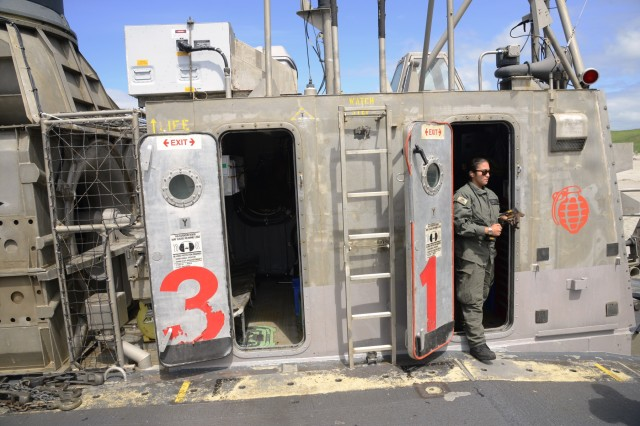A U.S. Navy LCAC (Landing Craft Air Cushion) crew member prepares to re-load equipment back onto LCAC-31 prior to departing the Sunset Beach area near Warrenton, Oregon, June 3, 2019. Community leaders, emergency managers, military officials and other first responders toured the U.S.S Anchorage and two of the ship's LCAC (Landing Craft Air Cushion) vehicles to learn more about Navy capabilities to assist in mass casualty scenarios.