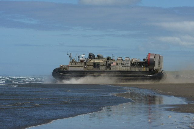 A U.S. Navy (Landing Craft Air Cushion) LCAC-31 leaves the shore at the Sunset Beach area near Warrenton, Oregon, June 3, 2019. In addition to the beach landings by the hovercraft vehicles, community leaders, emergency managers, military officials and other first responders toured the U.S.S. Anchorage to learn more about the Navy capabilities to assist in mass casualty scenarios.
