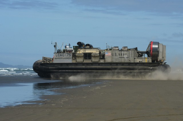 A U.S. Navy (Landing Craft Air Cushion) LCAC-75 leaves the shore at the Sunset Beach area near Warrenton, Oregon, June 3, 2019. In addition to the beach landings by the hovercraft vehicles, community leaders, emergency managers, military officials and other first responders toured the U.S.S. Anchorage to learn more about the Navy capabilities to assist in mass casualty scenarios.