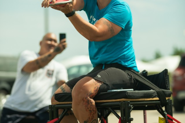 U.S. Army Staff Sgt., Retired, Beth King prepares to throw a discus during Field practice on June 19, 2019, MacDill Airbase during the 2019 Department of Defense Warrior Games. The DoD Warrior Games are conducted June 21 - 30, hosted by Special Operations Command, Tampa, Florida. It is an adaptive sports competition for wounded, ill and injured service members and veterans. Approximately 300 athletes representing teams from the Army, Marine Corps, Navy, Air Force, Special Operations Command, United Kingdom Armed Forces, Australian Defence Force, Canadian Armed Forces, Armed Forces of the Netherlands, and the Danish Armed Forces will compete in archery, cycling, shooting, sitting volleyball, swimming, track, field, wheelchair basketball, indoor rowing, powerlifting, and for the first time in Warrior Games history, golf, wheelchair tennis, wheelchair rugby, and mountain biking. (U.S. Army photo by Staff Sgt. Michael Loggins)