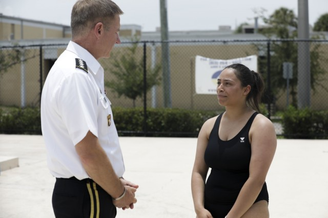 U.S. Army Pfc. Kyia Costanzo speaks with Army Vice Chief of Staff Gen. James McConville June 22, 2019 at the Bobby Hicks Swimming Pool during a training session for the Department of Defense Warrior Games. The DoD Warrior Games are conducted June 21-20, hosted by Special Operations Command, Tampa, Florida. It is an adaptive sport competition for wounded, ill, and injured service members and veterans. Approximately 300 athletes representing teams from Army, Marine Corps, Navy, Air Forces, Special Command, United Kingdom Armed Forces, Australian Defense Force. Canadian Armed Force of the Netherlands, and the Danish Armed Forces will compete in archery, cycling, shooting, sitting volleyball, swimming, track, field, wheelchair basketball, indoor rowing, powerlifting, and for the first time in Warrior Games history, golf, wheelchair tennis, and wheelchair ruby.