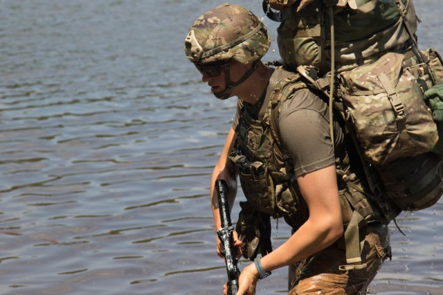 Sgt. Zachary Babin, practical nursing specialist with 759th Forward Surgical Team, 44th Medical Brigade, returns from submerging his rucksack in McKellar's Pond, during the combat water survival training event of the 2019 XVIII Airborne Corps Noncommissioned Officer and Soldier of the Year Competition at Fort Bragg, N.C. June 24, 2019. The competition places the best of the best against each other in a week-long competition. (U.S. Army Photo by Pfc. Joshua Cowden / 22nd Mobile Public Affairs Detachment)