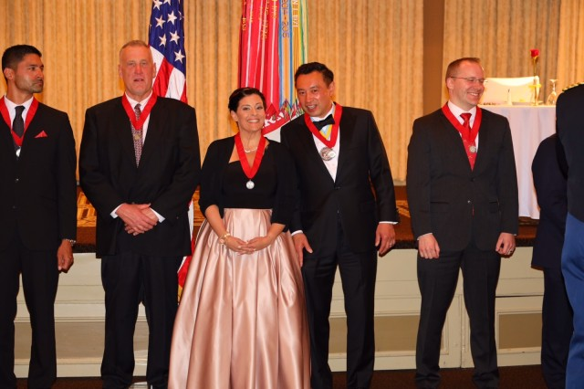 Jaclyn D'Olivo of ACC-NJ received the Honorable Order of Saint Barbara Medal for her work on M1156 Precision Guided Kits (PGK), a GPS guided adapter for field artillery used by U.S. service men and foreign allies.