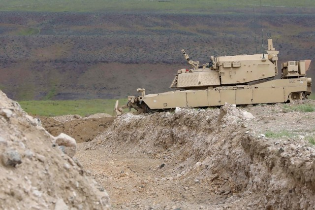 A remote-controlled concept assault breacher vehicle prepares to breach an obstacle during field testing at the Joint Warfighting Assessment 19, April 28, 2019. Gen. John Murray, head of Army Futures Command, said robotic combat vehicles will change the way Army formations look and fight.