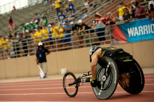 U.S. Army retired Sgt. Johnathan Weasner races on his racing wheelchair during the track competition, June 22, 2019, during the 2019 Department of Defense Warrior Games in Tampa, Florida. Approximately 300 athletes representing teams from the Army, Marine Corps, Navy, Air Force, Special Operations Command, United Kingdom Armed Forces, Australian Defence Force, Canadian Armed Forces, Armed Forces of the Netherlands, and the Danish Armed Forces are participating in 13 events throughout the competition. (U.S. Army photo by Staff Sgt. Michael Loggins)