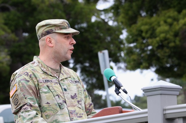 Outgoing commander, Lt. Col. (Dr.) Brian Lanier, addresses the attendees of the California Medical Detachment's change of command ceremony on Soldier Field in Monterey, Calif., on June 20. CAL MED falls under Madigan's command.