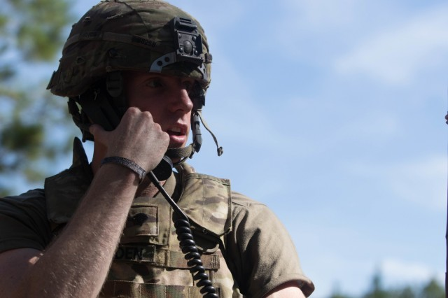 Spc. Joel Boulden, assigned to 10th Mountain Division, radios in a call for fire during day two of the 2019 XVIII Airborne Corps Noncommissioned Officer and Soldier of the Year competition at Fort Bragg, N.C. June 25, 2019. The competition places some of the best Soldiers in the Army against each other in a series of mental and physical challenges to determine who will be the Soldier and the Noncommissioned Officer of the Year. (U.S. Army Photo by Pfc. Joshua Cowden / 22nd Mobile Public Affairs Detachment)
