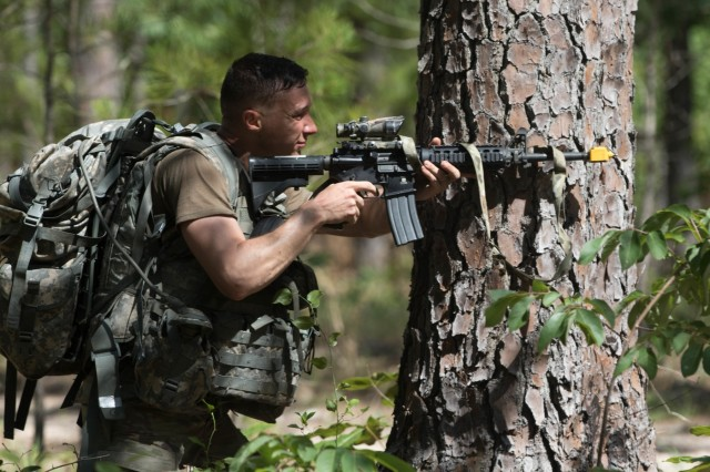 Sgt. Nicolas Branch, a multichannel transmission systems operator-maintainer with the 82nd Airborne Division, reacts to contact during day two of the 2019 XVIII Airborne Corps Noncommissioned Officer and Soldier of the Year competition at Fort Bragg, N.C. June 25, 2019. The competition places some of the best Soldiers in the Army against each other in a series of mental and physical challenges to determine who will be the Soldier and the Noncommissioned Officer of the Year. (U.S. Army Photo by Pfc. Joshua Cowden / 22nd Mobile Public Affairs Detachment)