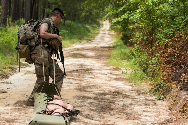 Sgt. Darren Kim, an infantryman with the 101st Airborne Division (Air Assault), moves a simulated casualty with a litter to a secure area during day two of the 2019 XVIII Airborne Corps Noncommissioned Officer and Soldier of the Year Competition at Fort Bragg, N.C. June 25, 2019. The competition places the best of the best against each other in a grueling week of mental and physical tests. (U.S. Army Photo by Pfc. Joshua Cowden / 22nd Mobile Public Affairs Detachment)