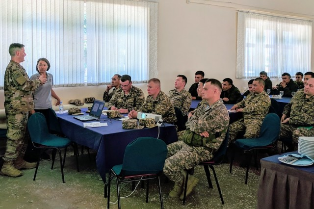 U.S. Army physician, Maj. Michael Eiffert, M.D. (far left), presents a Tactical Combat Casualty Care and Health Service Support in Peacekeeping Operations class, June 20, 2019, to medical participants at Steppe Eagle 19 at Illisky Training Area in Kazakhstan. The class was designed to teach medical providers from Kazakhstan, Tajikistan, and the Kyrgyz Republic about trauma care and preventive medicine. (Photo by U.S. Army Maj. Kevin Sandell)