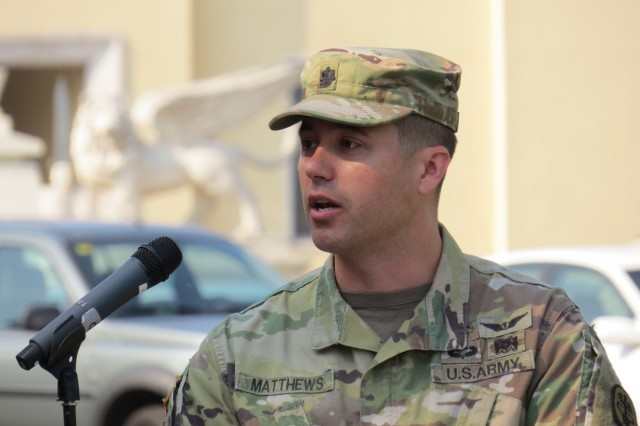 Lt. Col. Joseph Matthews, commander, U.S. Army Health Clinic - Vicenza, speaks during a change of command ceremony Lt. Col. Kane D. Morgan relinquished command of U.S. Army Health Clinic - Vicenza to Matthews at Hoekstra Field, Caserma Ederle, Italy, June 25. (U.S. Army photo by Tamara Passut)