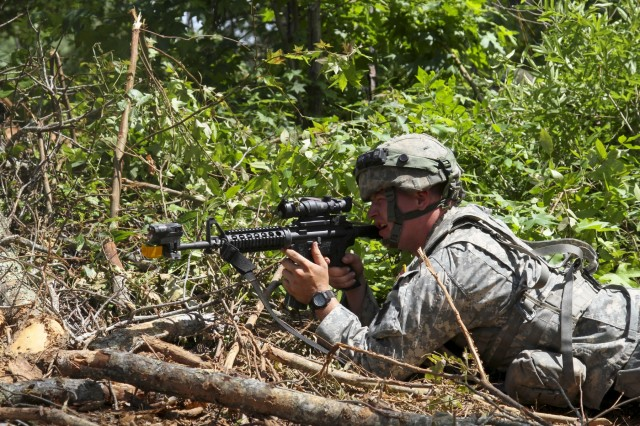 A Pennsylvania National Guard Soldier from A Company, 128th Brigade Support Battalion, 2nd Brigade, 28th Infantry Division, maintain security after a probing attack by opposing force soldiers during eXportable Combat Training Capability 19-02 at Fort Pickett, Va. on June 18, 2019.