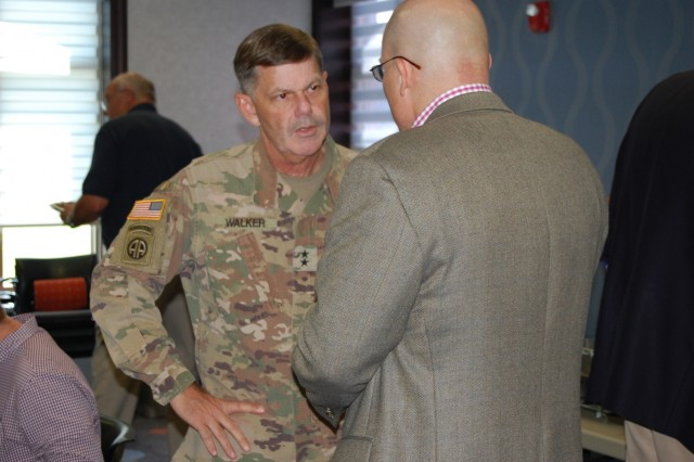 "Knox Regional Development Alliance (KRDA) President/CEO Jim Iacocca shares some ideas with Maj. Gen. Flem B. ""Donnie"" Walker Jr., commanding general, 1st Theater Sustainment Command, during a community luncheon June 25, 2019 in Elizabethtown, Ky."