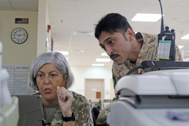 U.S. Army Capt. Theresa Terry, 349th Combat Support Hospital, shows computer systems to Awadh Hamoud, a Kuwait Army nurse, at Camp Arifjan's U.S. Military Hospital - Kuwait June 17, 2019.  (U.S. Army National Guard photo by Sgt. Connie Jones)