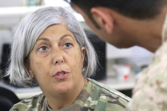 U.S. Army Capt. Theresa Terry, 349th Combat Support Hospital, explains a program to a nurse in the Kuwait Army at Camp Arifjan's U.S. Military Hospital - Kuwait June 17, 2019. (U.S. Army National Guard photo by Sgt. Connie Jones)