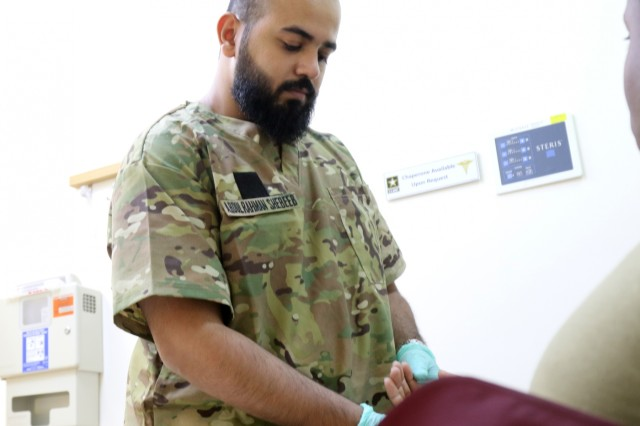 Abdul Rahman Shabeeb, a Kuwait Army nurse, learns with a simulated patient at Camp Arifjan's U.S. Military Hospital - Kuwait June 17, 2019. (U.S. Army National Guard photo by Sgt. Connie Jones)